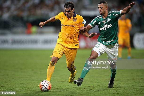 Vitor Hugo of Palmeiras fights for the ball with German Herrera of Rosario during a match between Palmeiras and Rosario as part of Group 2 of Copa...