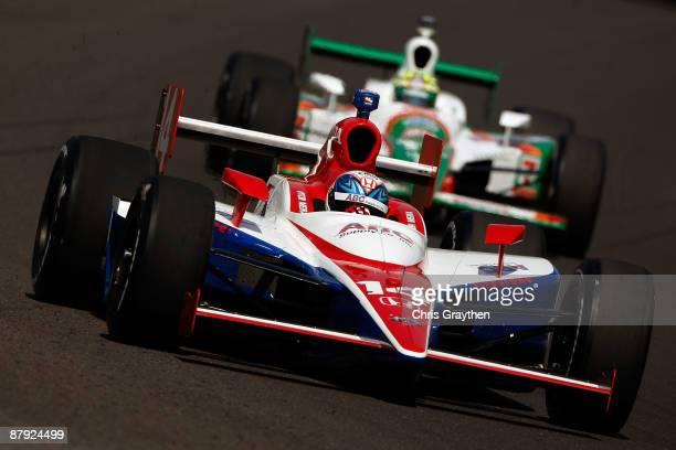 Vitor Meira drives in the ABC Supply Co AJ Foyt Racing Dallara Honda ahead of Tony Kanaan in the Team 7Eleven Andretti Green Racing Dallara Honda...