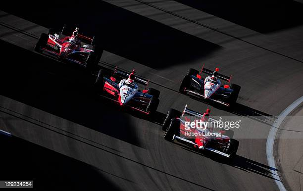 Vitor Meira of Brazil driver of the A J Foyt Enterprises Dallara Honda leads a pack of cars during practice for the IZOD IndyCar Series World...