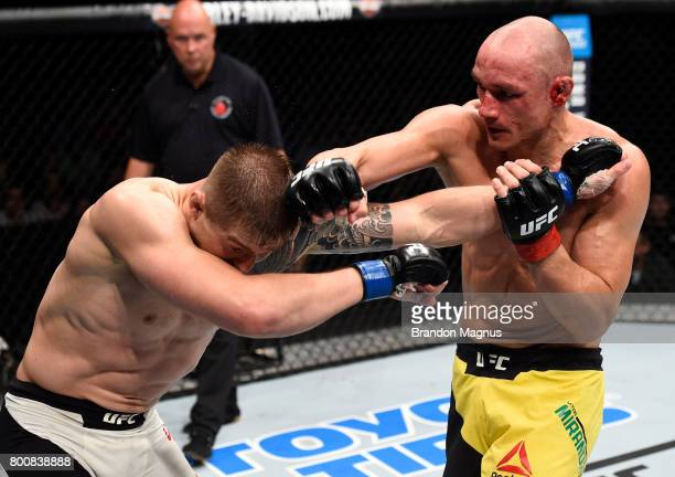 Vitor Miranda of Brazil punches Marvin Vettori of Italy in their middleweight bout during the UFC Fight Night event at the Chesapeake Energy Arena on...