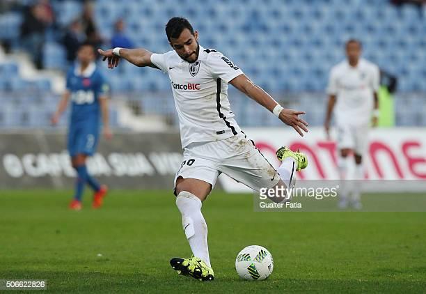 Vitoria de Guimaraes' forward Henrique Dourado scores a goal during the Primeira Liga match between Os Belenenses and Vitoria de Guimaraes at Estadio...