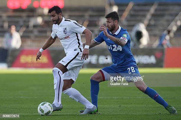 Vitoria de Guimaraes' forward Henrique Dourado with Os Belenenses' defender Goncalo Brandao in action during the Primeira Liga match between Os...