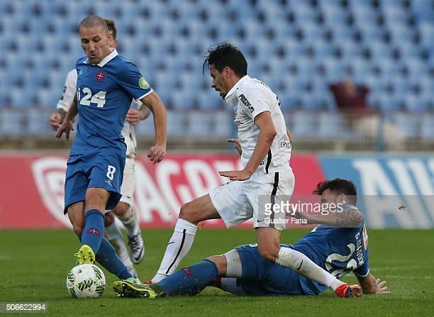 Vitoria de Guimaraes' forward Lica tackled by Os Belenenses' defender Goncalo Brandao and Os Belenenses' midfielder Andre Sousa during the Primeira...