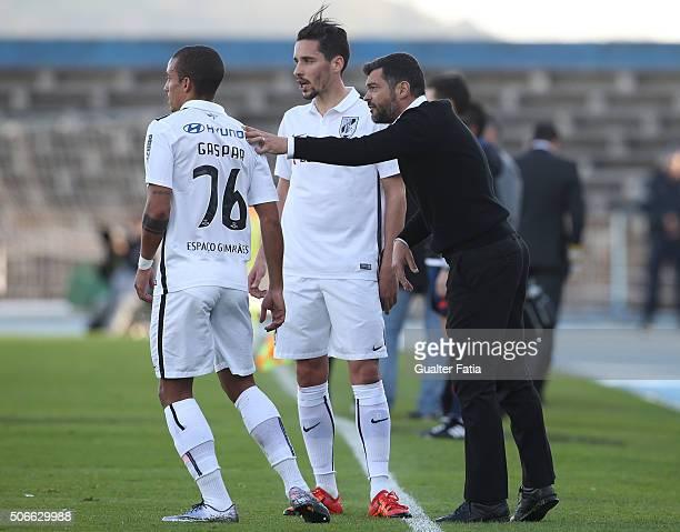 Vitoria de Guimaraess coach Sergio Conceicao talks to Vitoria de Guimaraess defender Bruno Gaspar and Vitoria de Guimaraess forward Lica during the...
