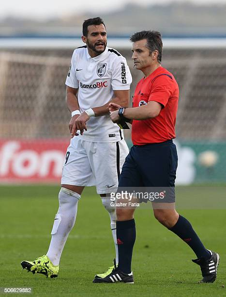 Vitoria de Guimaraess forward Henrique Dourado talks to referee Rui Costa during the Primeira Liga match between Os Belenenses and Vitoria de...