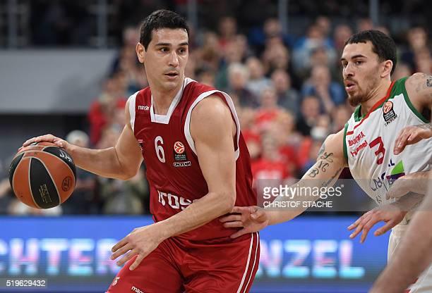 Vitoria Gasteiz US guard Mike James and Bamberg's Greece guard Nikolaos Zisis vie for the ball during the EuroLeague top 16 Group F basketball match...