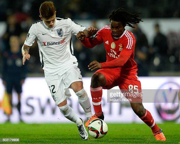Vitoria Guimaraes' Brazilian defender Otavinho vies with Benfica's midfielder Renato Sanches during the Portuguese league football match Vitoria SC...