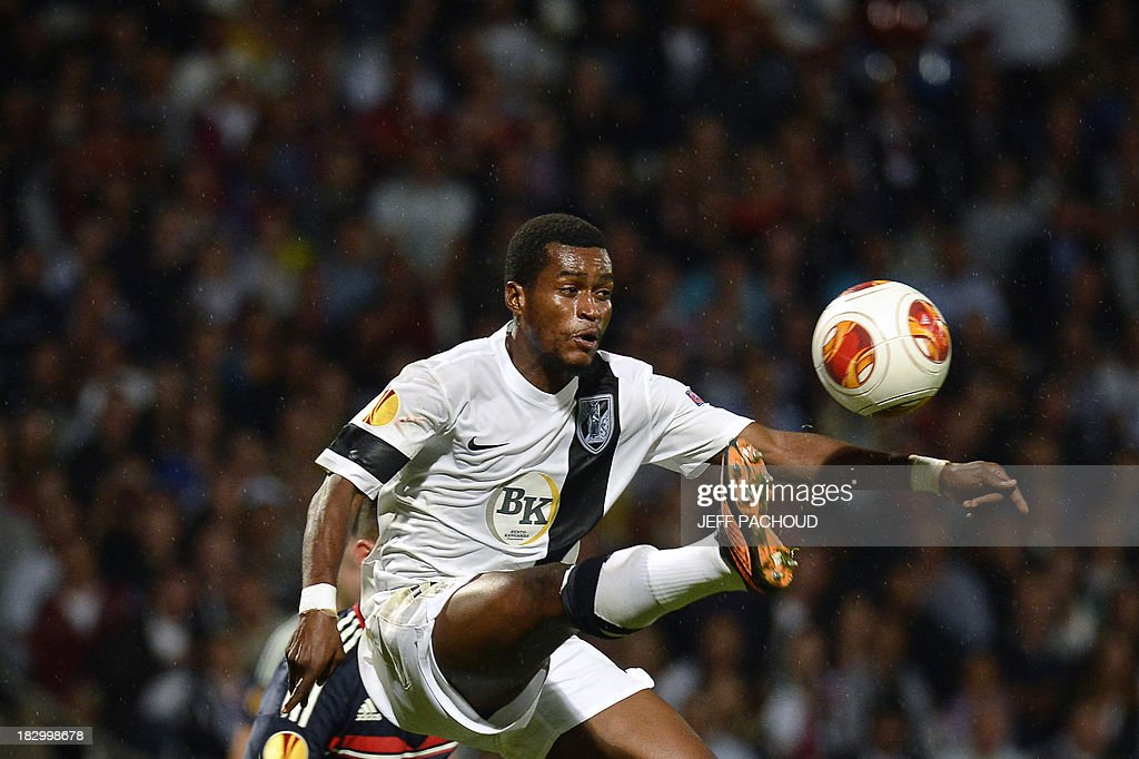 Vitoria Guimaraes' Burkinabe forward Nii Plange jumps for the ball during the UEFA Europa League group I football match Olympique Lyonnais (OL) vs Vitoria Guimaraes on October 3, 2013, at the Gerland Stadium in Lyon, central-eastern France.