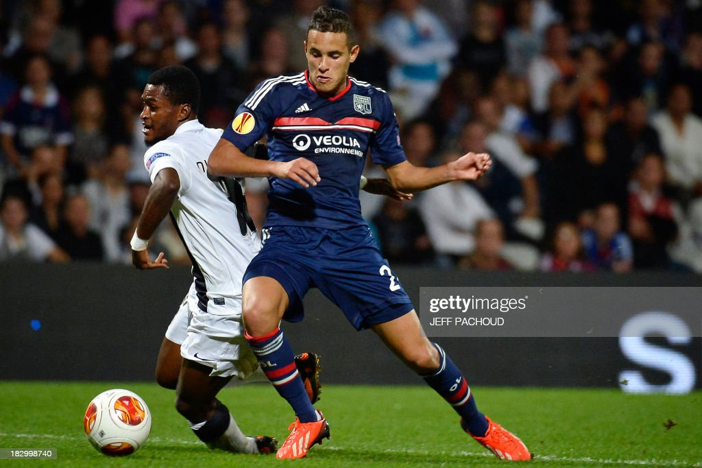 Vitoria Guimaraes' Burkinabe forward Nii Plange (L) vies for the ball with Lyon's French defender Mehdi Zeffane (R) during the UEFA Europa League group I football match Olympique Lyonnais (OL) vs Vitoria Guimaraes on October 3, 2013, at the Gerland Stadium in Lyon, central-eastern France.