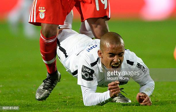 Vitoria Guimaraes' defender Bruno Gaspar falls on the pitch during the Portuguese league football match Vitoria SC vs SL Benfica at the Dom Afonso...