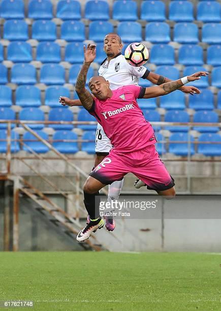 Vitoria Guimaraes' defender Bruno Gaspar with Estoril's forward Paulo Henrique from Brazil in action during the Primeira Liga match between GD...