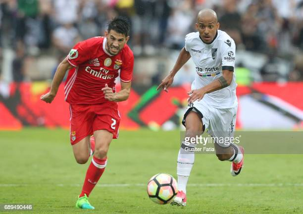 Vitoria Guimaraes' defender Bruno Gaspar with SL Benfica's midfielder from Portugal Pizzi in action during the Portuguese Cup Final match between SL...