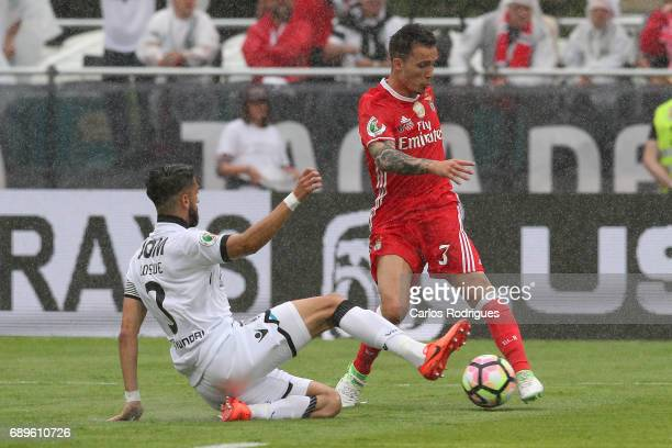 Vitoria Guimaraes defender Josue Sa from Portugal tries to stop Benfica's defender Alejandro Grimaldo from Spain during the match between SL Benfica...