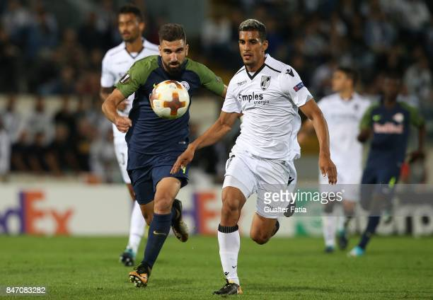 Vitoria Guimaraes defender Victor Garcia from Venezuela with RB Salzburg forward Munas Dabbur from Greece in action during the UEFA Europa League...