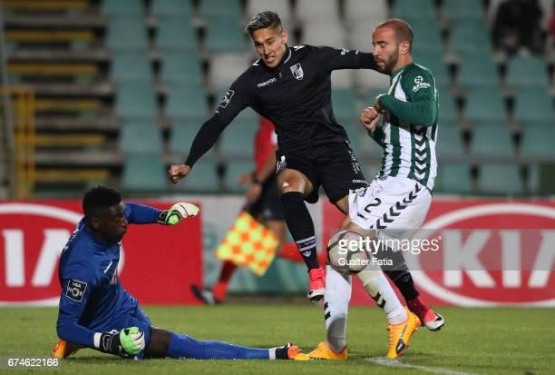 Vitoria GuimaraesÕ forward David Teixeira with Vitoria de SetubalÕs defender Pedro Pinto and Vitoria de SetubalÕs goalkeeper Bruno Varela in action...