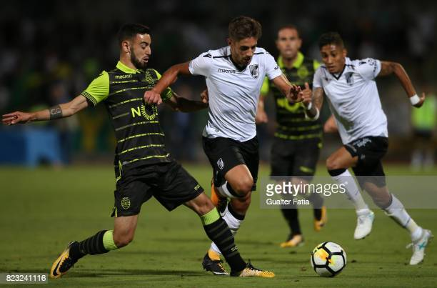 Vitoria Guimaraes forward Joao Vigario from Portugal with Sporting CP midfielder Bruno Fernandes from Portugal in action during PreSeason Friendly...
