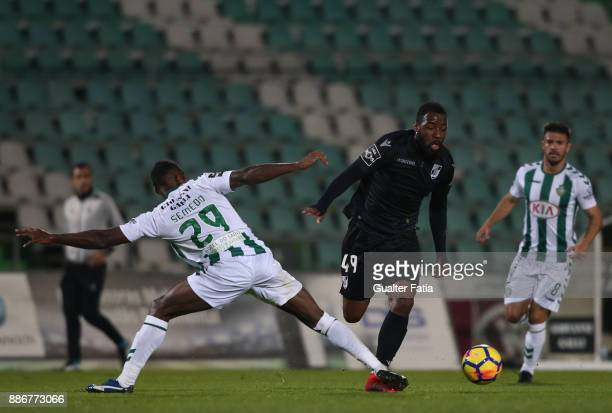 Vitoria Guimaraes forward Junior Tallo from Ivory Coast with Vitoria Setubal defender Semedo from Portugal in action during the Primeira Liga match...