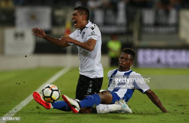 Vitoria Guimaraes forward Paolo Hurtado from Peru tackled by FC Porto midfielder Mikel Agu from Nigeria during the PreSeason Friendly match between...