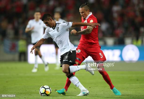 Vitoria Guimaraes forward Paolo Hurtado from Peru with SL Benfica midfielder Ljubomir Fejsa from Serbia in action during the SuperTaca match between...