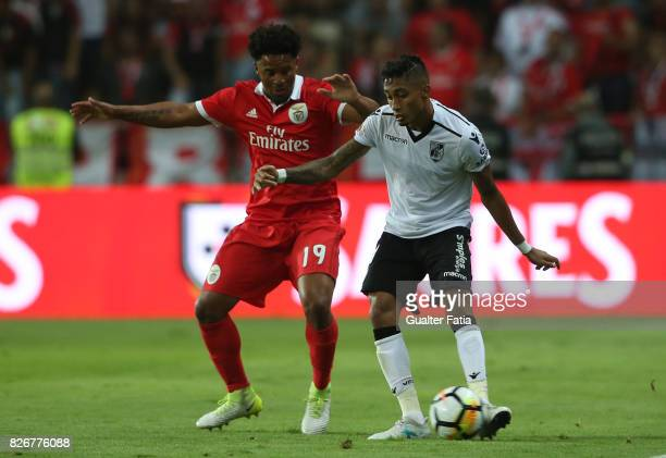 Vitoria Guimaraes forward Raphinha from Brasil with SL Benfica defender Eliseu from Portugal in action during the SuperTaca match between SL Benfica...