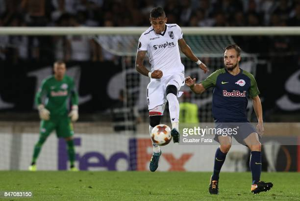 Vitoria Guimaraes forward Raphinha from Brazil with RB Salzburg defender Andreas Ulmer from Austria in action during the UEFA Europa League match...