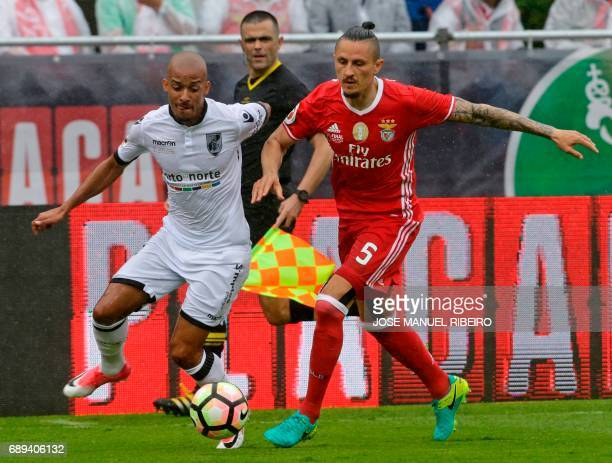 Vitoria Guimaraes French forward Moussa Marega vies with Benfica's Serbian midfielder Ljubomir Fejsa during the Portugal's Cup final football match...