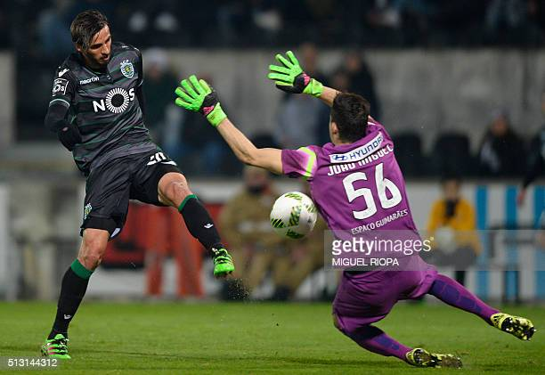 Vitoria Guimaraes' goalkeeper Miguel Silva stops a ball kicked by Sporting's Costa Rican forward Bryan Ruiz during the Portuguese league football...