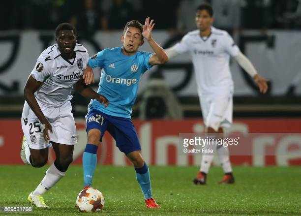 Vitoria Guimaraes midfielder Alhassan Wakaso from Ghana with Olympique Marseille Maxime Lopez from France in action during the UEFA Europa League...