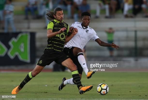 Vitoria Guimaraes midfielder Bongani Zungu from South Africa with Sporting CP midfielder Matheus Oliveira from Brazil in action during PreSeason...