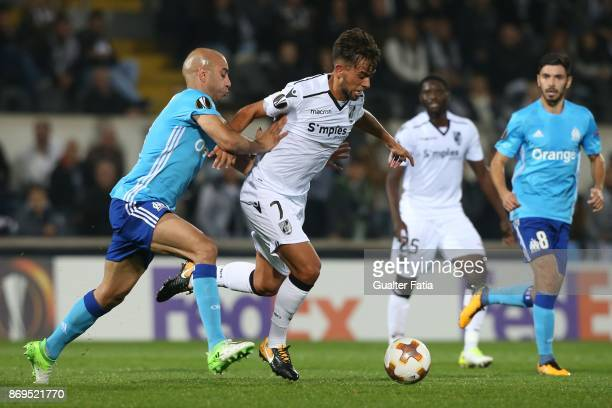 Vitoria Guimaraes midfielder Francisco Ramos from Portugal with Olympique Marseille Aymen Abdennour from Tunisia in action during the UEFA Europa...