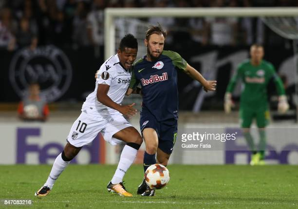 Vitoria Guimaraes midfielder Heldon from Brazil with RB Salzburg defender Andreas Ulmer from Austria in action during the UEFA Europa League match...