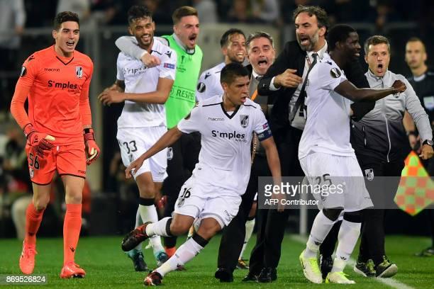 Vitoria Guimaraes' Peruvian midfielder Paolo Hurtado celebrates with teammates after scoring a goal during the UEFA Europa League group I football...