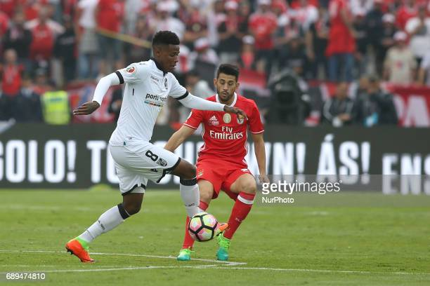 Vitoria Guimaraes' South African midfielder Bongani Zungu vies with Benfica's Portuguese forward Pizzi during the Portugal Cup Final football match...
