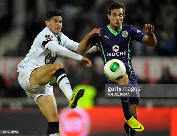 Vitoria SC's Argentinian midfielder Jean Barrientos vies with Sporting's defender Cedric Soares during the Portuguese league football match Vitoria...