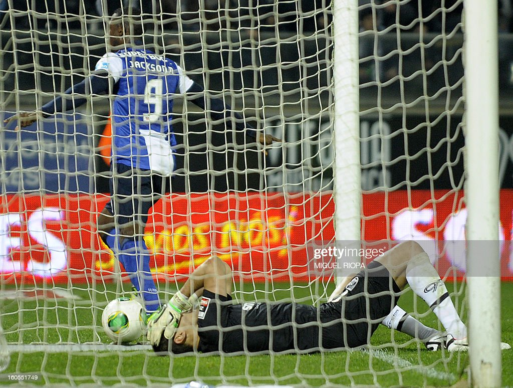 Vitoria SC's Brazilian goalkeeper Douglas reacts after the second goal scored by Porto's Colombian forward Jackson Martinez (L) during the Portuguese league football match Vitoria SC vs FC Porto at the D.Afonso Henriques Stadium in Guimaraes on February 2, 2013.