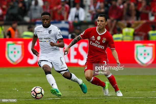 Vitoria SC's forward Hernani vies for the ball with Benfica's defender Alejandro Grimaldo during the Portugal Cup football final match between SL...