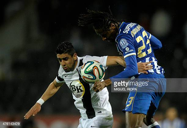 Vitoria SC's forward Marco Matias jumps for the ball with Porto's Senegalese defender Abdoulaye during the Portuguese league football match Vitoria...