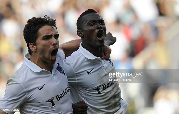 Vitoria SC's Ghanaian midfielder Bernard Mensah celebrates with his teammate forward Tomane after scoring during the Portuguese league football match...