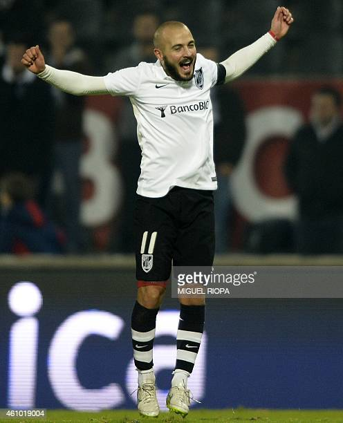 Vitoria SC's midfielder Andre Andre celebrates after scoring a goal during the Portuguese league football match Vitoria de Guimaraes v CD Nacional at...