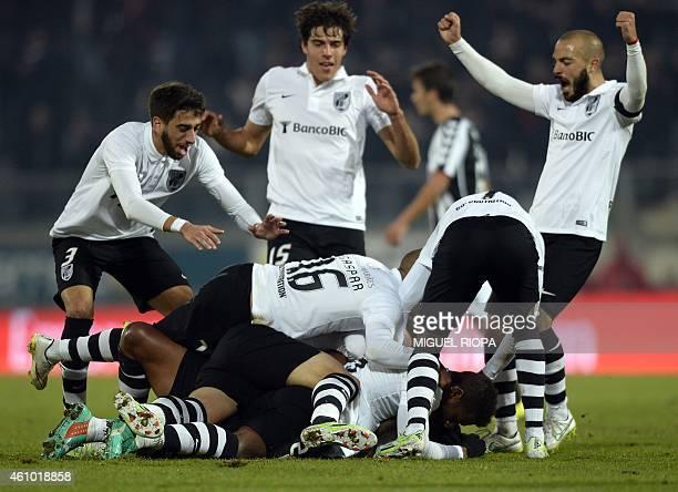 Vitoria SC's players celebrate after scoring the opening goal during the Portuguese league football match Vitoria de Guimaraes v CD Nacional at the...