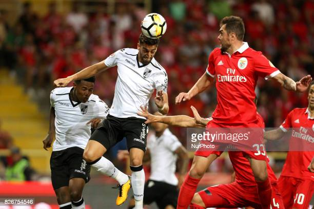 Vitoria SC's Portuguese defender Josue Sa in action with Benfica's Brazilian defender Jardel during the Candido Oliveira Super Cup match between SL...