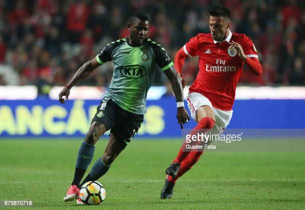 Vitoria Setubal forward Arnold Issoko from Congo with SL Benfica midfielder Andreas Samaris from Greece in action during the Portuguese Cup match...