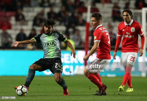 Vitoria Setubal forward Joao Amaral from Portugal with SL Benfica defender Alejandro Grimaldo from Spain in action during the Primeira Liga match...