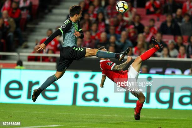 Vitoria Setubal midfielder Andre Sousa from Portugal tries to stop Benfica's defender Alejandro Grimaldo from Spain during the match between SL...