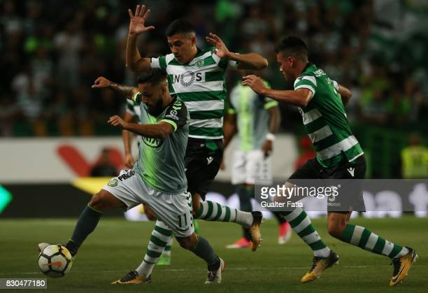 Vitoria Setubal midfielder Joao Costinha from Portugal with Sporting CP midfielder Rodrigo Battaglia from Argentina and Sporting CP defender Jonathan...