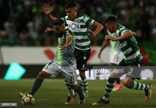 Vitoria Setubal midfielder Joao Costinha from Portugal with Sporting CP midfielder Rodrigo Battaglia from Argentina with Sporting CP defender...