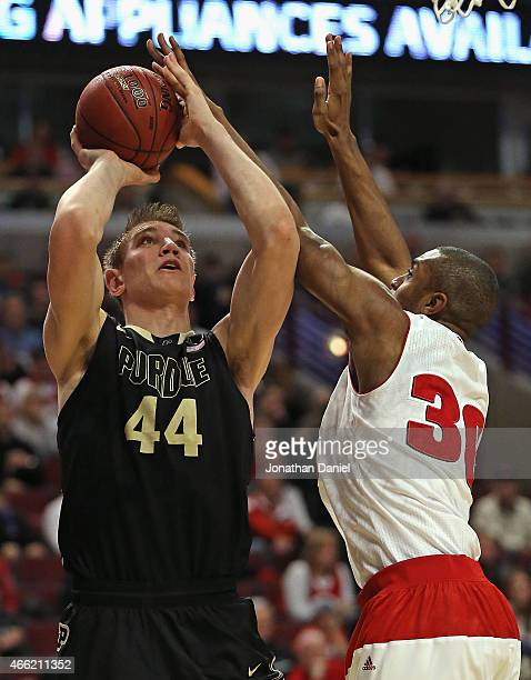 Vitto Brown of the Wisconsin Badgers blocks a shot by Isaac Haas of the Purdue Boilermakers during the semifinal round of the 2015 Big Ten Men's...
