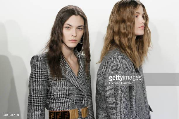Vittoria Ceretti and model are seen backstage ahead of the Fendi show during Milan Fashion Week Fall/Winter 2017/18 on February 23 2017 in Milan Italy