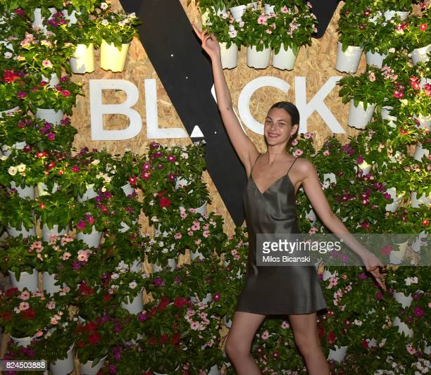 Vittoria Ceretti poses for a photo during the Velocity Black party on July 29 2017 in Mykonos Greece