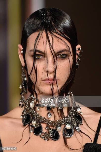 Vittoria Ceretti walks the runway during the Alexander McQueen Paris show as part of the Paris Fashion Week Womenswear Spring/Summer 2018 on October...